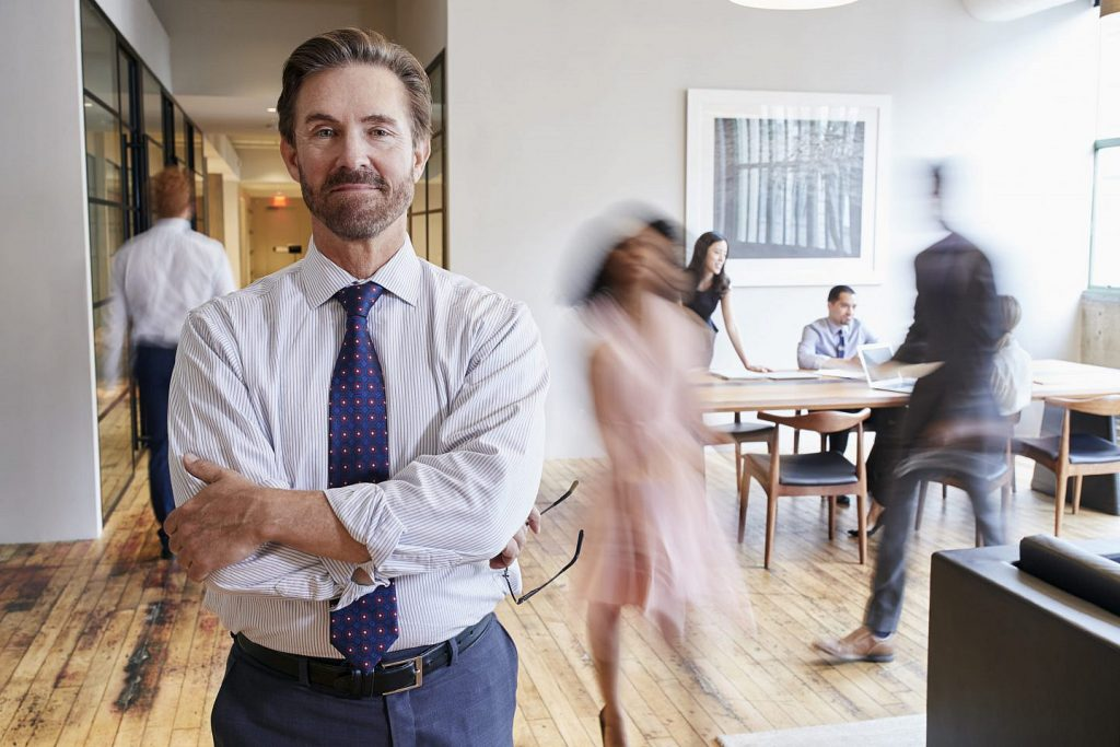 portrait-of-middle-aged-white-man-in-a-busy-PEZGY3X-1024x683